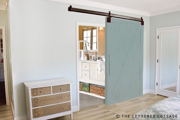 Blue barn door for the bathroom