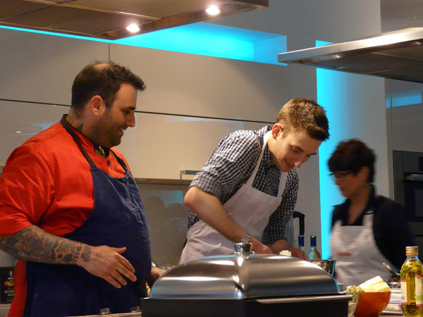 Will Taylor helps chef Adam Schop at the Miele dining Event