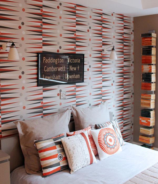 Bedroom featuring Backgammon Wallpaper in Harvest Orange by Mini Moderns